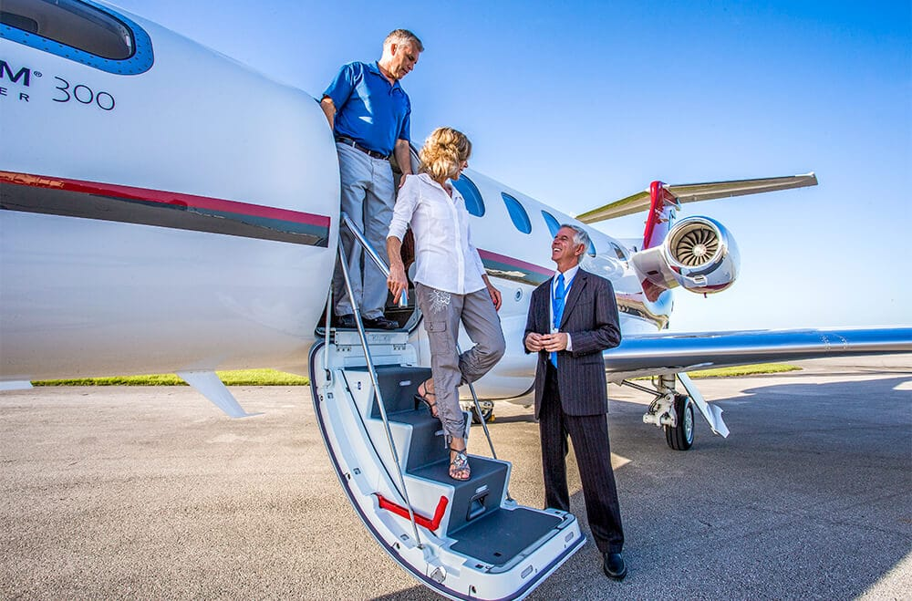 Couple Deboarding Phenom 300