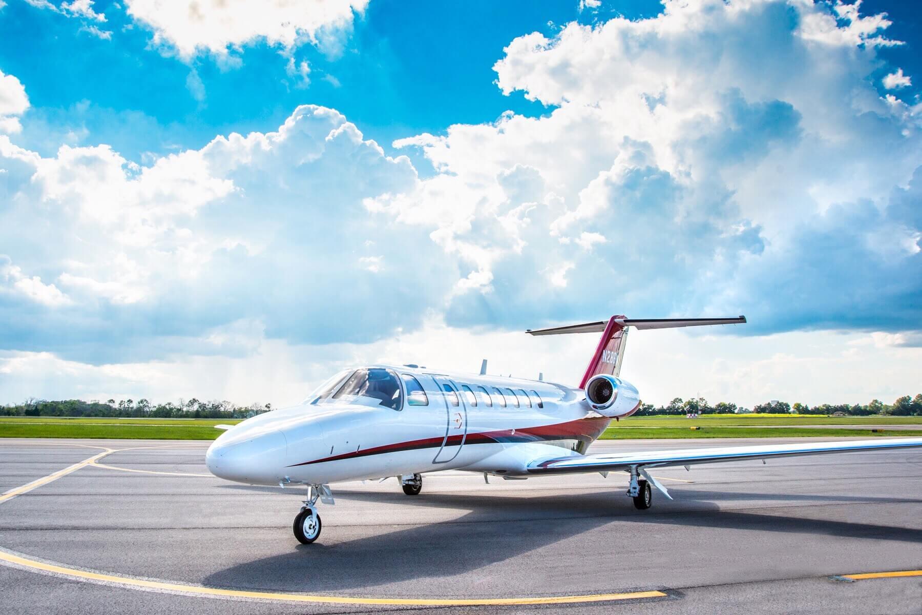 Cessna Citation CJ3 on Tarmac with Bright Blue Sky
