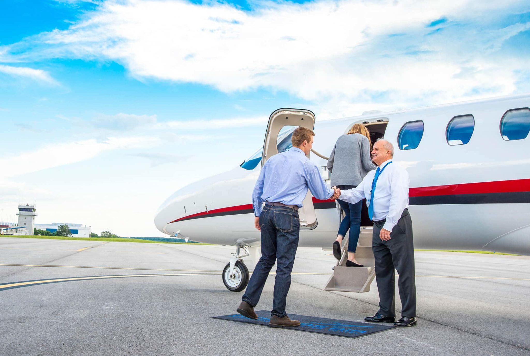 Couple Boarding Cessna Citation CJ3 Shaking Pilots Hand
