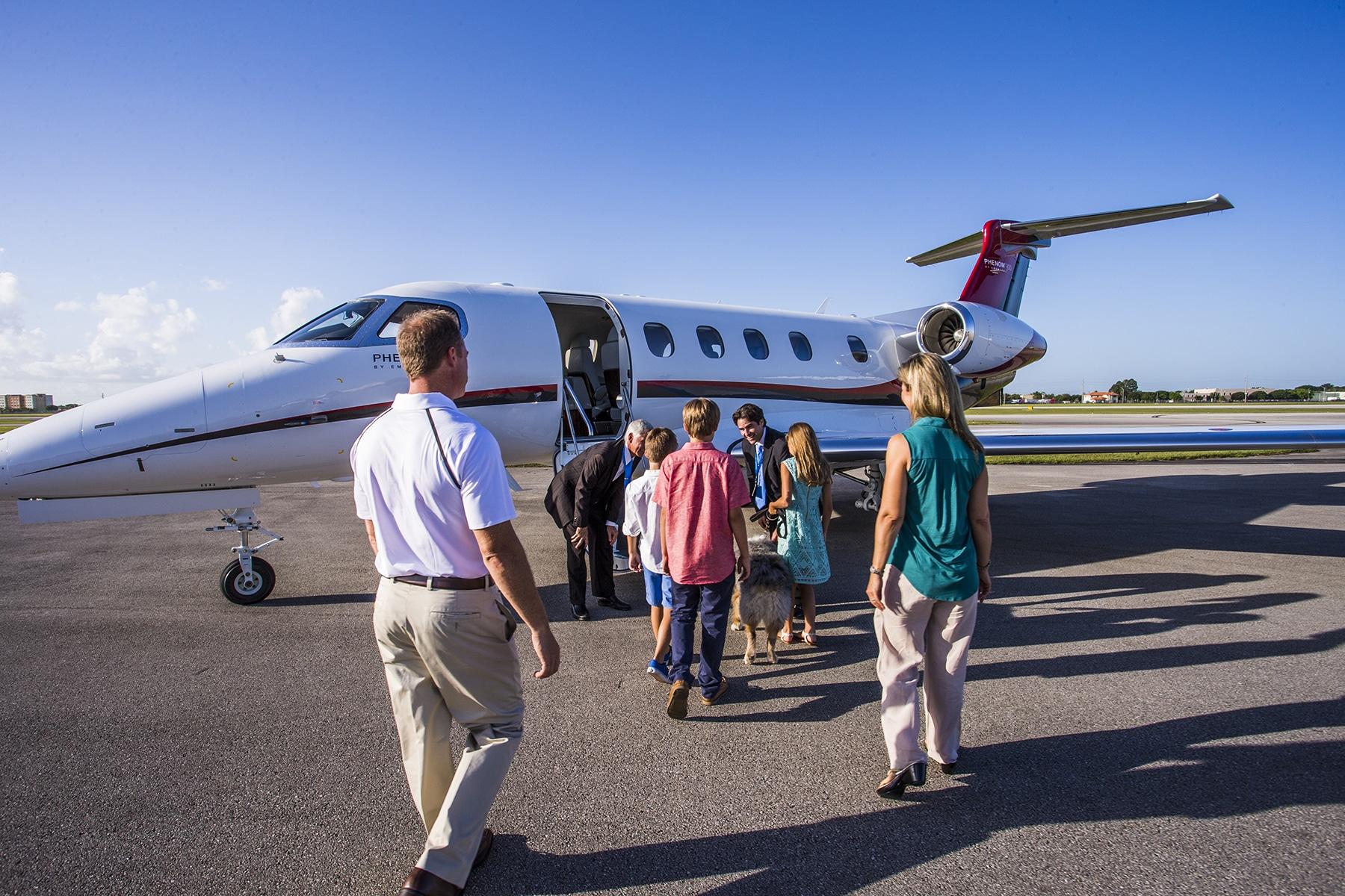 Family Boarding Nicholas Air Embraer Phenom 300