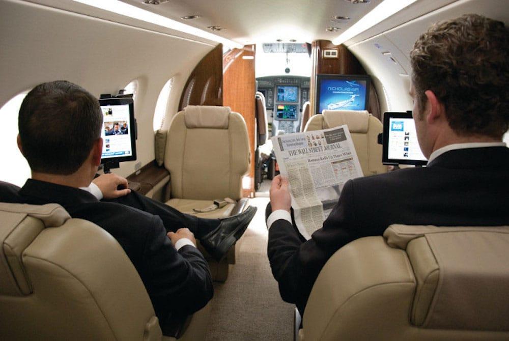 Businessmen Onbard Pilatus PC-12