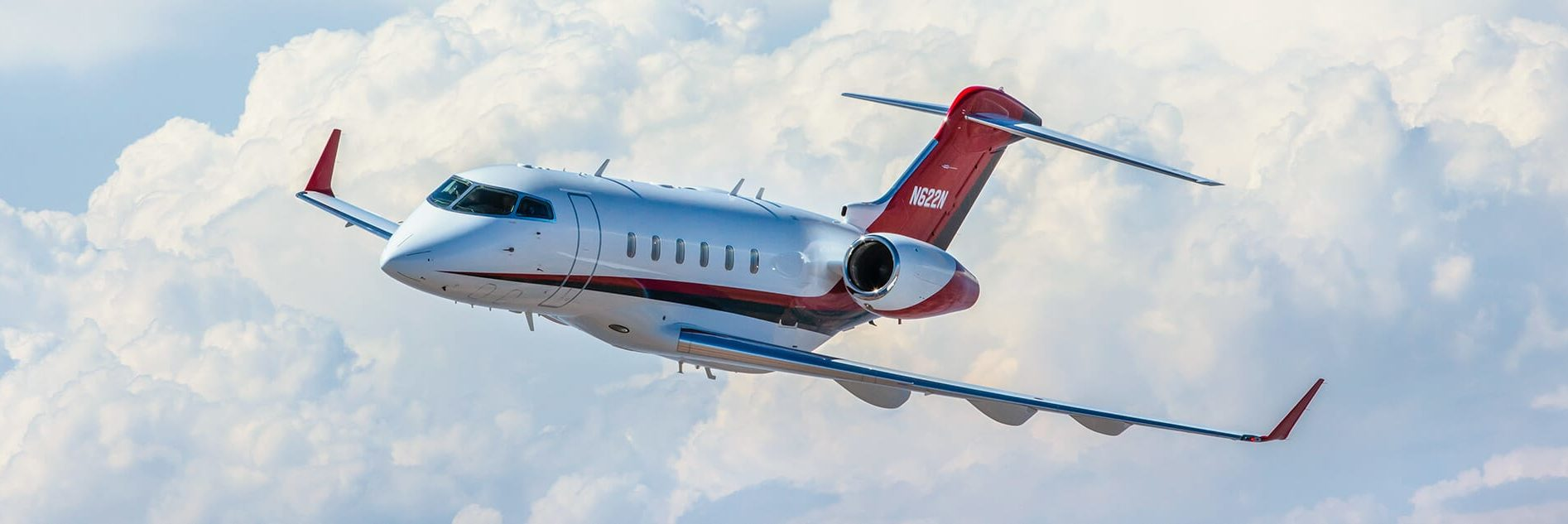 Challenger 300 Against Blue Sky and Clouds
