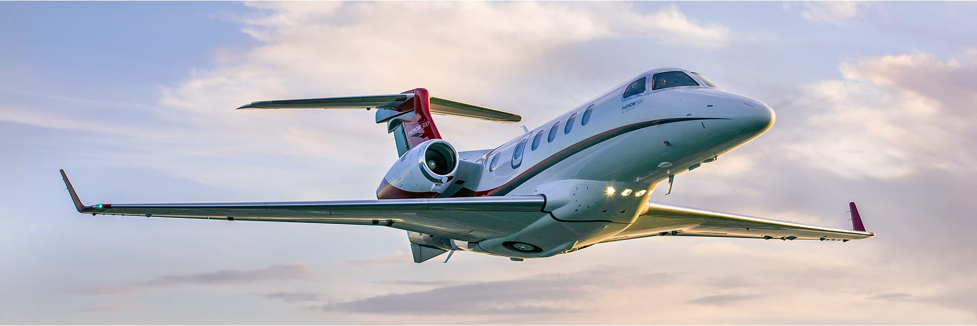 Phenom 300 Aerial Against Pink and Blue Sky
