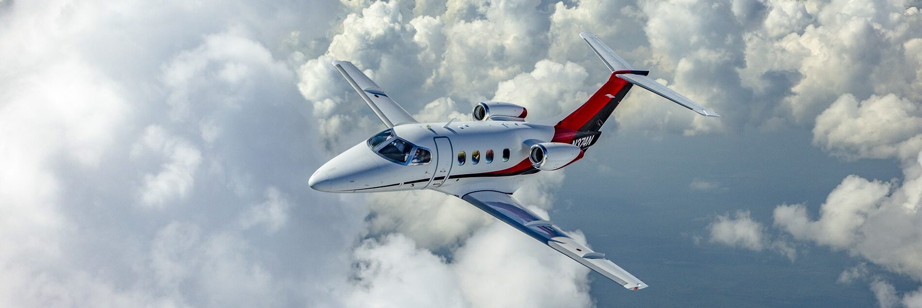 Embraer Phenom 100 Aerial White Clouds
