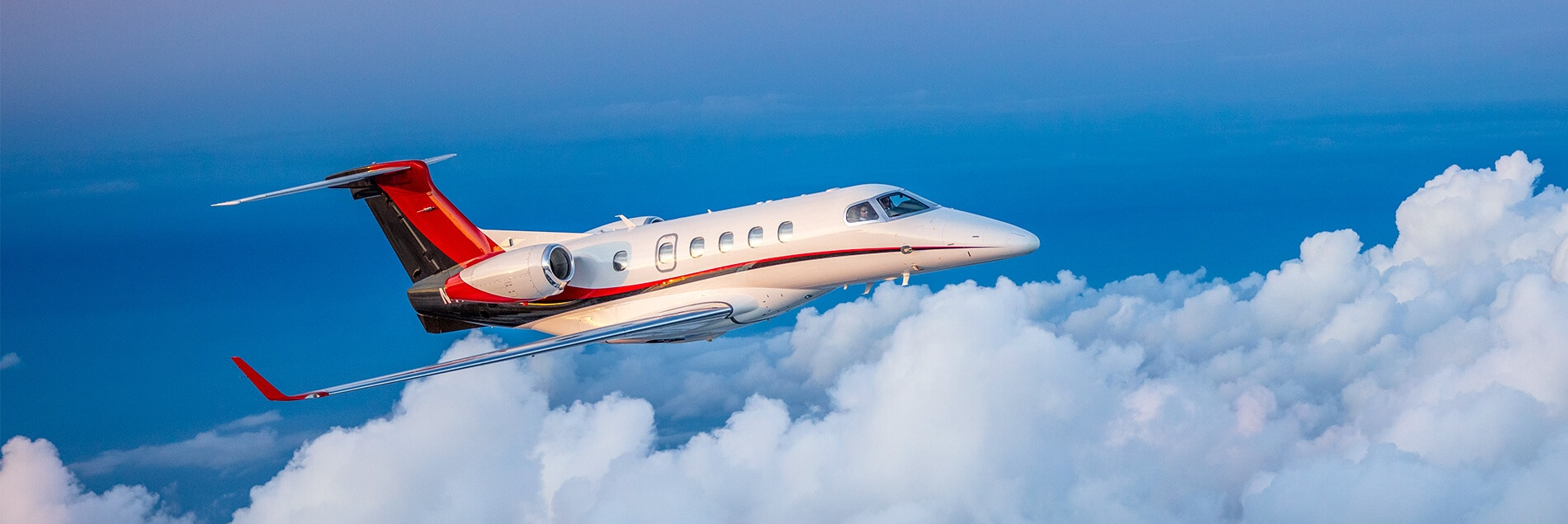 Embraer Phenom 300 in Clouds
