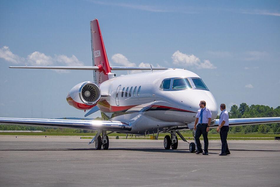 Nicholas Air Pilots Walking in Front of Cessna Citation Latitude