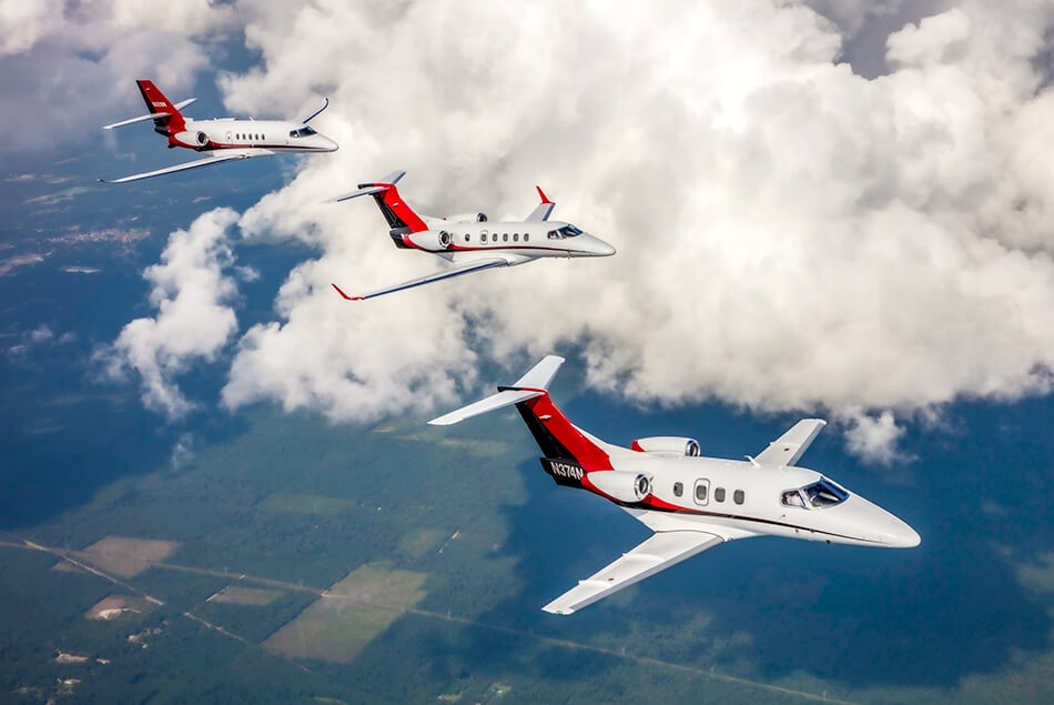 Embraer Phenom 100, Embraer Phenom 300, and Cessna Citation Latitude in Aerial Formation