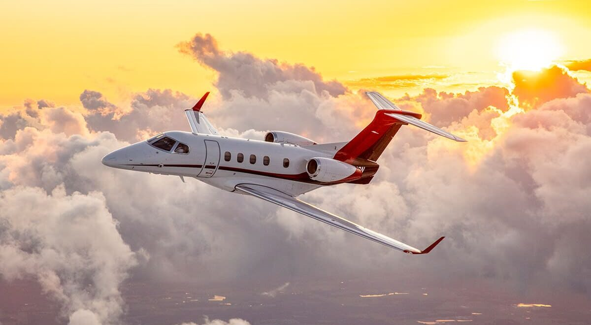 Embraer Phenom 300E Aerial with Sunset in Background