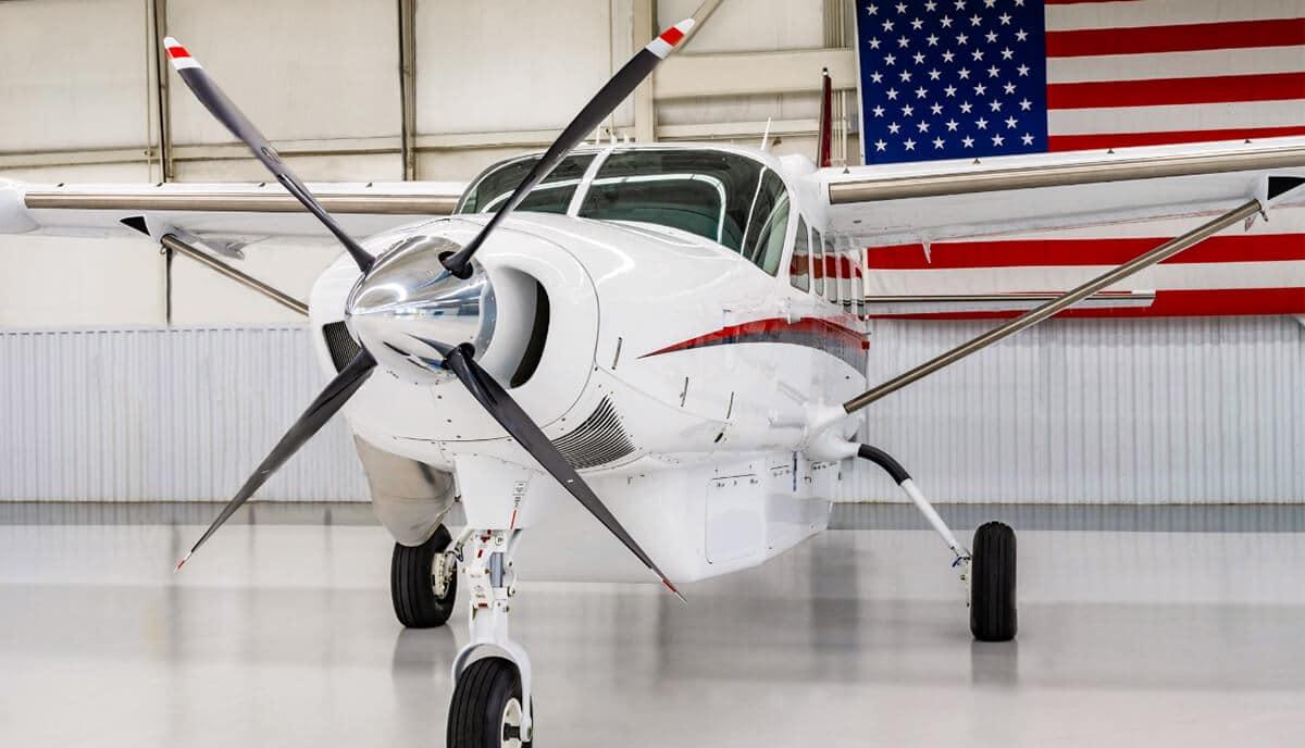 Cessna Caravan in Hangar with American Flag behind
